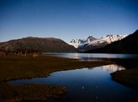 Cerro Azul, Krueger Peak, Cerro Mellizo, in starlight reflections in Rio Pasqu flowing from Lago O'Higgins, Aisen Province, Chil