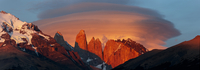 Dawn light with sweeping lenticular clouds over Torres del Paine, UN Biosphere Preserve, Torres del Paine National Park, Chile