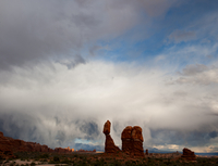 Storm clouds over Balanced Rock, Arches National Park in sunset light, Utah, USA