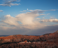 Moon rising over the eroded Claron Formation hoodoos, below Sunset Point. Bryce National Park, Utah. July 2012.