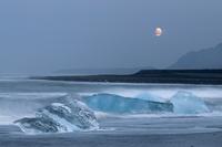 Glacier ice laying on black volcanic sand. Oraefi, Iceland.June 2008