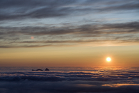 The view of Sanna (Taena) in sea fog, from the top of the Lundeura (Lovund, Luroy) in the Midnight Sun,Helgeland, Nordland, Nor