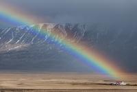 Rainbow over landscape, Varmahl��, Iceland, April 2010