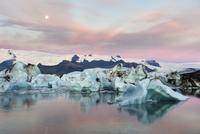 Jokulsarlon glacier lagoon at sunrise with full Moon, Iceland, September 2010