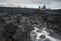 Londrangar surrounded by lava field, Snaefellsnes Peninsula, Iceland, February 2011