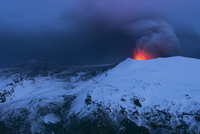 Ash plume and lava eruption from the Eyjafjallajokull volcano at night, Iceland, April 2010