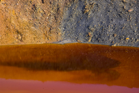 Rocks and water coloured by iron and other mineral deposits, Rio Tinto river, Huelva, Andalucia, Spain, January 2008