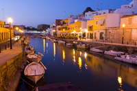 Boats moored along an inlet at dusk, Cuidadela, Menorca, Balearic Islands, Spain, Mediterranean, July 2005