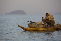ナイルで草舟に乗る漁師