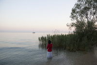 Girl in lake with boat