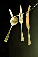 Cutlery pegged on line