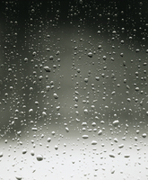 Water droplets on dark window pane