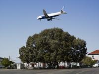 White aeroplane flying low