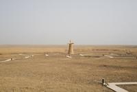 Windmill in grass field