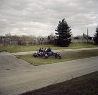 Young boys meeting together with their scooters