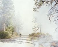 Fireman attending to a forest fire. U.S.A