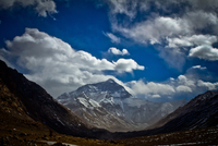 Mount Everest from the Tibetan base camp with valley of rock formation on either side. Tibet