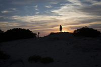 Silhouette of a woman watching the sunset Formentera, Spain
