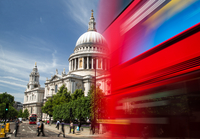 Blurred London bus passes St Pauls cathedral in The City of London. London, England, United Kingdom