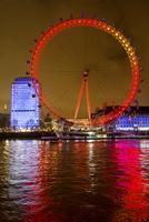London eye illuminated at night. London, England, United Kingdom