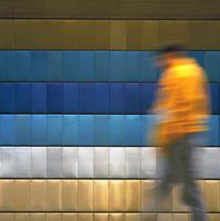 Man in yellow jacket walks on platform at Namesti Miru metro station. Prague, Czech Republic
