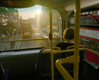 Woman sat on her own on the upper deck of a bus stares into the late evening sun. Battersea, South London, United Kingdom