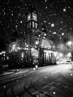 Marsden Mechanics Hall in snow storm at night. Yorkshire, England, United Kingdom
