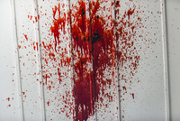 Blood splattered on a white wall