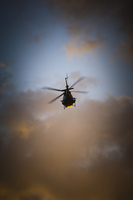 Police helicopter patrolling at sunset