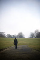Rear view of a man standing alone