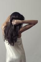 Slim woman with long dark hair