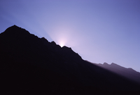 Sunset behind mountain ridge. Andes, Chile