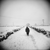 Figure on snow covered path