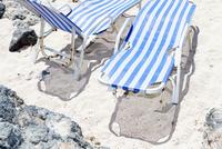 Striped sun loungers on beach. Crete