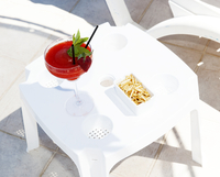 Red cocktail on a pool side table. Crete