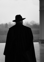 Rear view silhouette of a man in a coat and hat