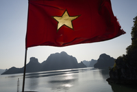 Vietnamese flag on a boat over the Halong Bay sea. Vietnam