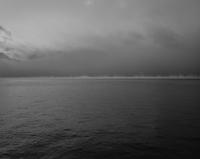 Dark murky lake. Lake Baikal, Russia
