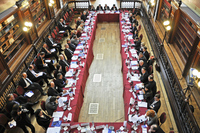 Business people around a large meeting table in a historic building. Brussels, Belgium