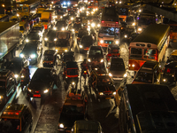 Different vehicles stuck in a traffic jam in the city at night. Bandra, Mumbai, India
