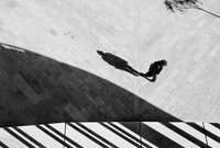 Aerial view of man walking with shadows. Provence, France