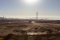 Car driving through barren oil fields. Azerbaijan