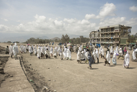 Pilgrims walking across road during Timkat festival. Lalibela, Ethiopia
