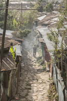Man walking through an alley in a shanty town. Addis Ababa, Ethiopia