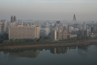Cityscape at dawn reflected in the Taedong river. Pyongyang, North Korea