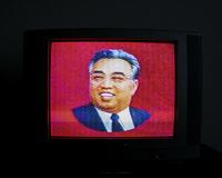 Image of Kim Il-sung political leader on TV. North Korea