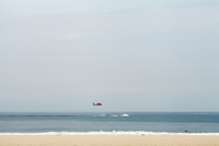 Helicopter flying above the sea. Venice beach, Los Angeles, U.S.A