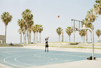 Basketball player practising on a court on Venice beach. Los Angeles, U.S.A