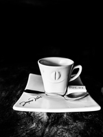 Still life of coffee cup and saucer in cafe. France