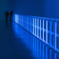 Two men in a blue room. An exhibit by Dan Flavin the Smithsonians Hirshhorn Museum, Washington DC. U.S.A